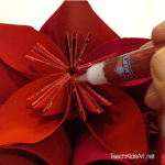 Origami Flower Balls - Step 6. Add glitter glue to edges if desired.