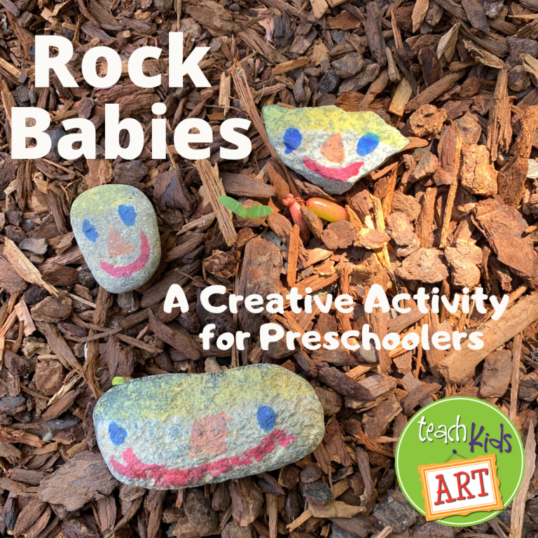 This is a photo of 3 small rocks, with cute faces drawn on them by a preschooler