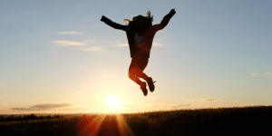 person jumping into the air with excitement