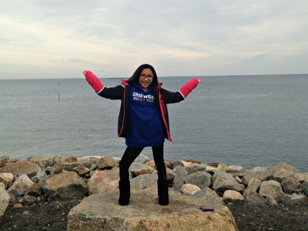 Isabella on the rocks near the beach in Rockport, MA