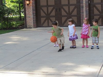 Roll the ball relay in preschool