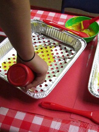 Painting on the grill in preschool