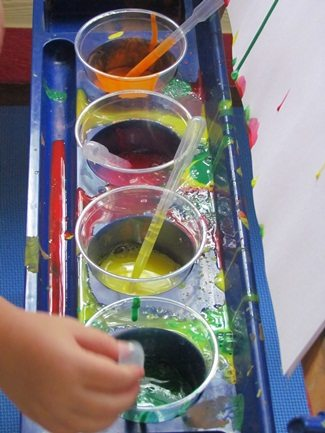 Drip drop painting at the easel