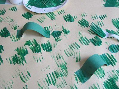 Inchworm gluing and painting activity in pre-kindergarten