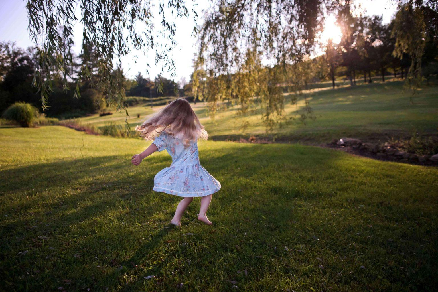 girl-playing-outside-in-summer-dress-playground-for-your-home-teachworkoutlove.com