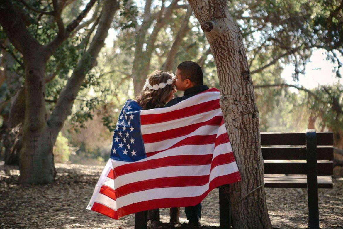 couple-in-american-flay-may-is-military-appreciation-month-teachworkoutlove.com