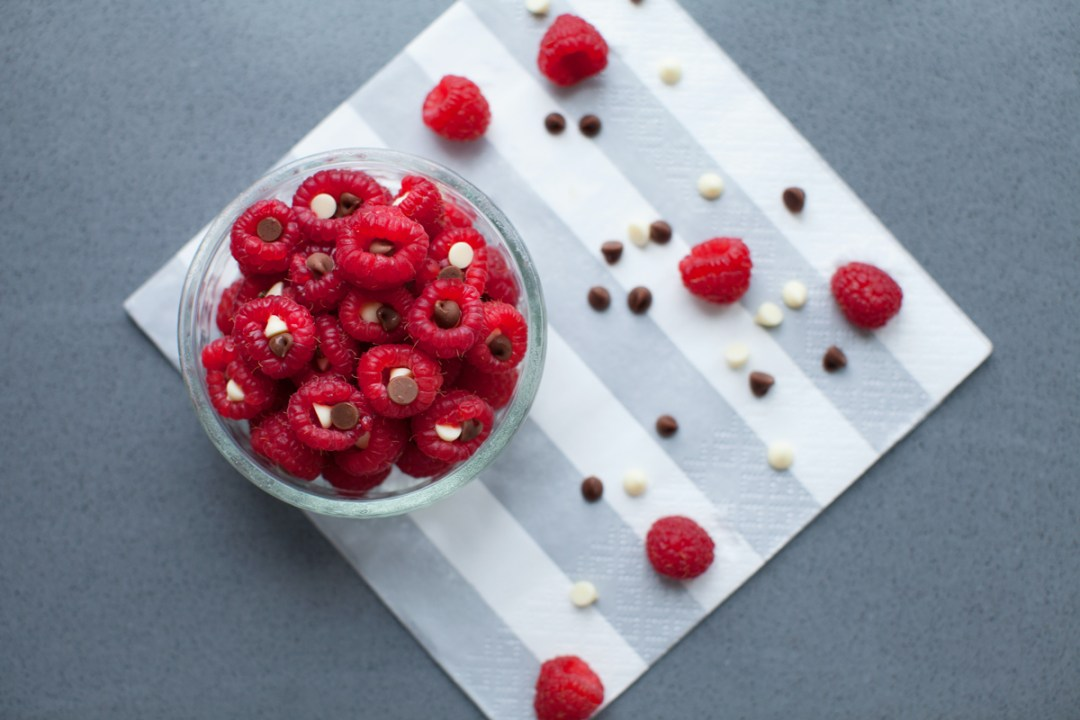 Raspberries filled with dark and white chocolate