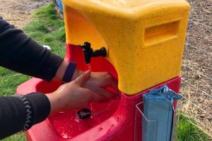 Hand washing on the farm with a Teal mobile sink