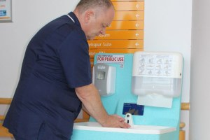 Hand washing with a Teal Mediwash unit to prevent the spread of norovirus
