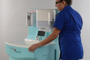 Wheeling a MediWash handwash unit into the required position on a hospital ward