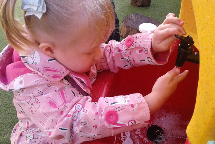 Teach handwashing to children to help prevent them getting ill