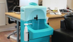 A Teal WashStand portable hand wash unit in an office