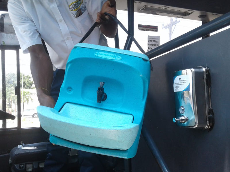 Portable hand wash units in Jamaica are being used by the Jamaica Urban Transit Company