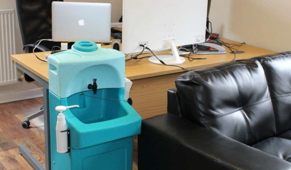 A Teal portable handwash station in an office