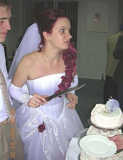 Cutting the Wedding Cake, Funny Wedding Pictures, Bad Wedding Photos,Wedding disasters, disastrous weddings, ugly wedding dresses, bad wedding dresses, wedding photography, wedding photographers, horrible weddings, wedding invitations, affordable weddings, worst wedding pictures
