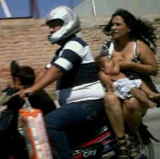 breast feeding on motorcycle Worst Parents Bad Parents Bad Parenting Moms Dads Awkward Family Photos Stupid Parents Crazy Bad Example Terrible Horrible Awful Weird