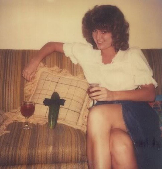 Woman on couch with cucumber Bad Family Photos Funny Family Pics Awkward Family Photos crazy weird bad tattoos worst tattoos stupid people Family Party ideas strange ugly