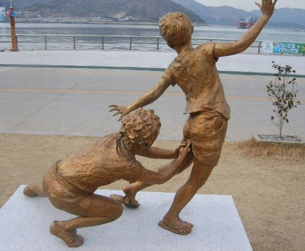 kid picking kid's butt Funny Statues Weird Statues Bizarre Sexual Strange Statues Awkward Crazy Art