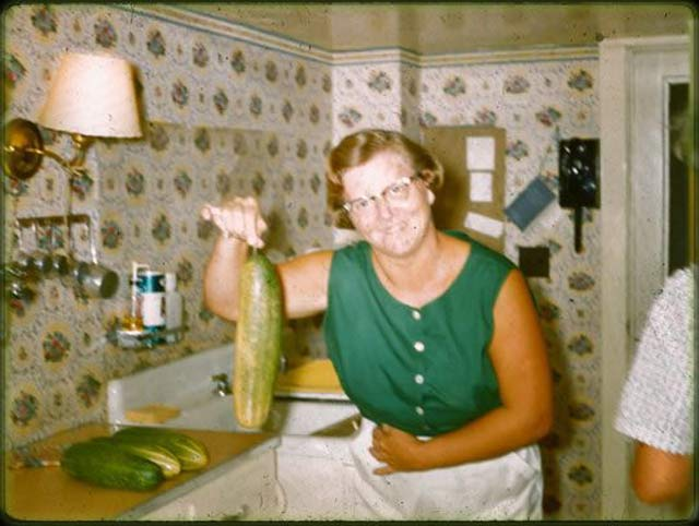 Vintage Snapshot: Woman in Kitchen with Giant Cucumber ~ 16 Funny Family Photos
