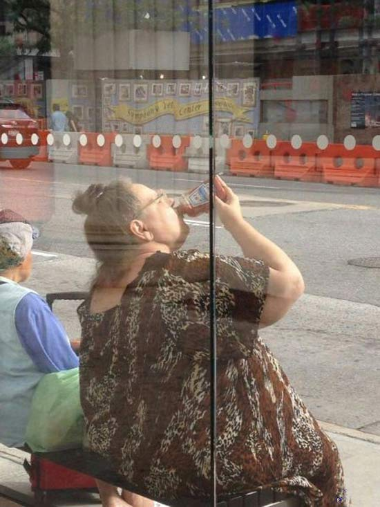 Woman Busstop drinking ketchup from bottle ~ 16 Funny Family Photos