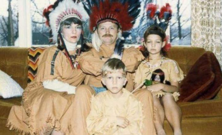 family portrait on couch dressed as indians for thanksgiving ~ 18 Funny Awkward Family Photos