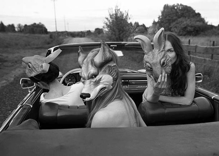 Black & White Photography: Three woman in animal masks riding in convertible
