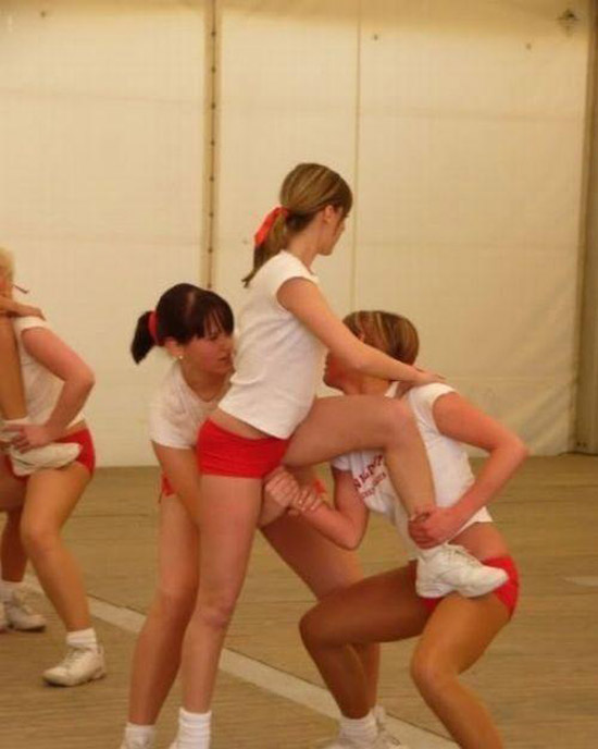 Perfectly timed photo of cheerleaders llifting with girls hands in her vagina ~ You have such a dirty mind