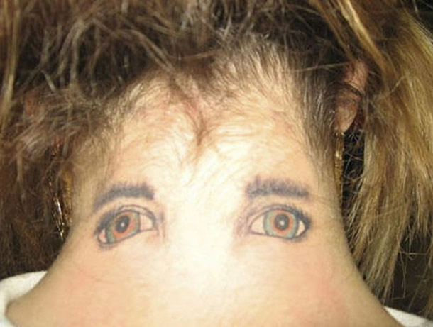 Eyes on Back of Woman's Neck