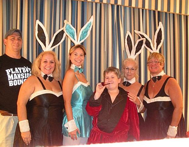 Family, Mom, Grandma, Sisters dressed as playboy bunnies with boy as Hugh Hefner