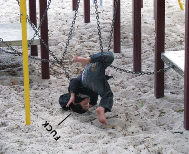 Fuck - Funny kid tangled up in swings at playground