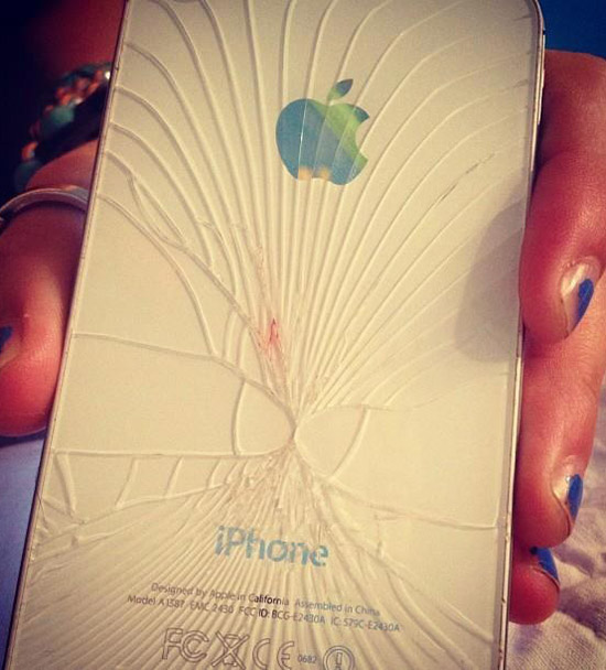 Broken, shattered iPhone with two cracks that look like penises