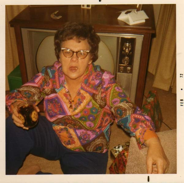 Vintage color snapshot of mom sitting on floor in front of tv drinking and drunk