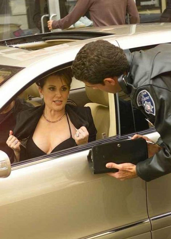woman in car flashing boobs police officer ticket awkward family photos