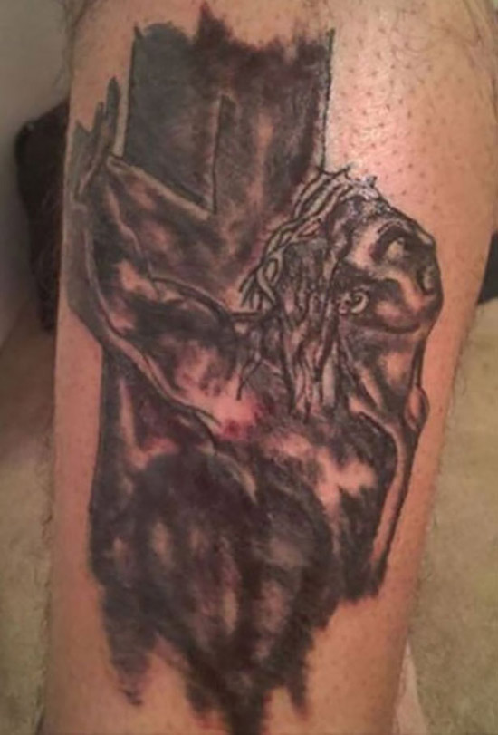 Bad Jesus nailed on the cross tattoo, black and burned worst