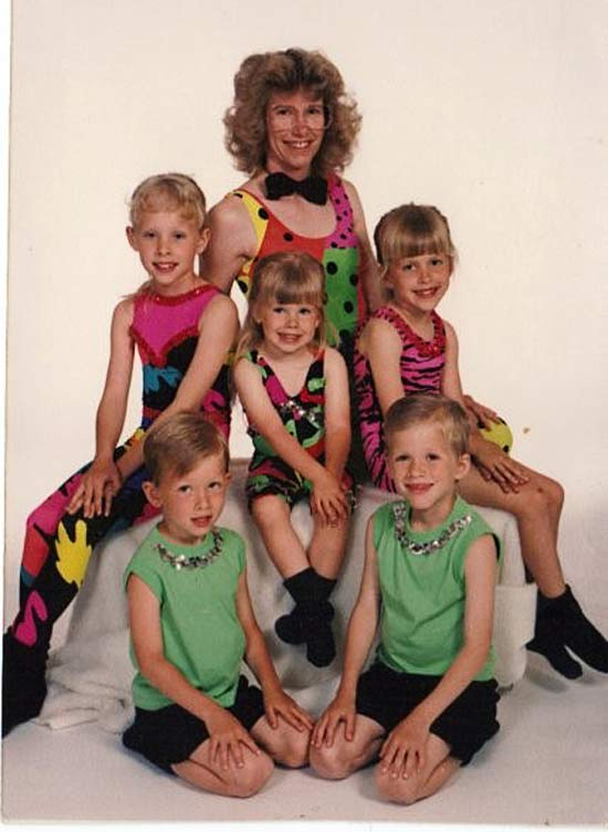 Awkward portrait of mom and goofy kids dressed in dance leotard 1980s