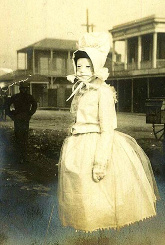 Creepy Old Vintage Photos~ woman floating no legs white dress mask