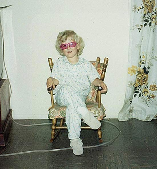 vintage color snap of young girl in rocking chair, great hair ~ Awkwardly Funny Family Photos