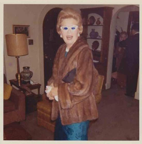 Vintage color snapshot 1960s of partying grandma in mink still and cat eyed glasses