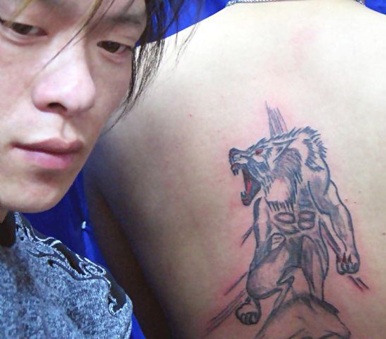 Chinese tattoo artist unhappy with his work wolf on back ~ The ugliest worst bad tattoos