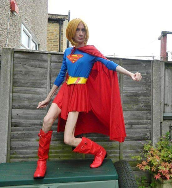 Awkward pic of man in Superman costume, red wig & boots