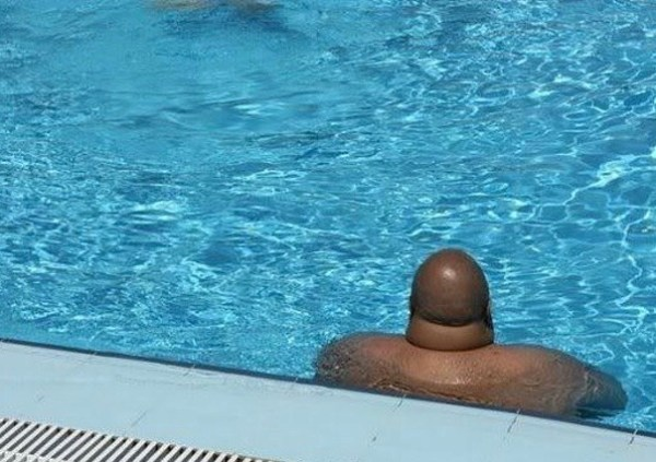 Funny, you wouldn't expect to find a penis there ~ man's head in pool
