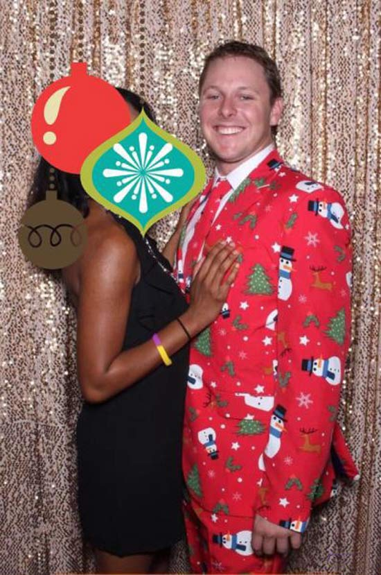 Funny awkward Christmas, couples portrait, sticker over woman's face, man in ugly suit
