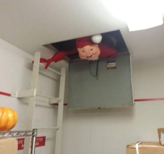 creepy-christmas-santa-attaic-door