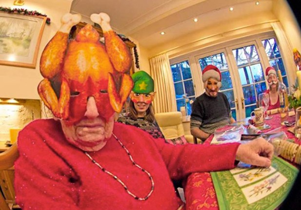 26 Funny Awkward Christmas Photos ~ Grandma in turkey mask