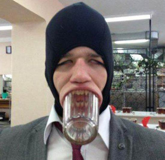 Funny Awkward Family Photos: man with whole glass stuck in his mouth