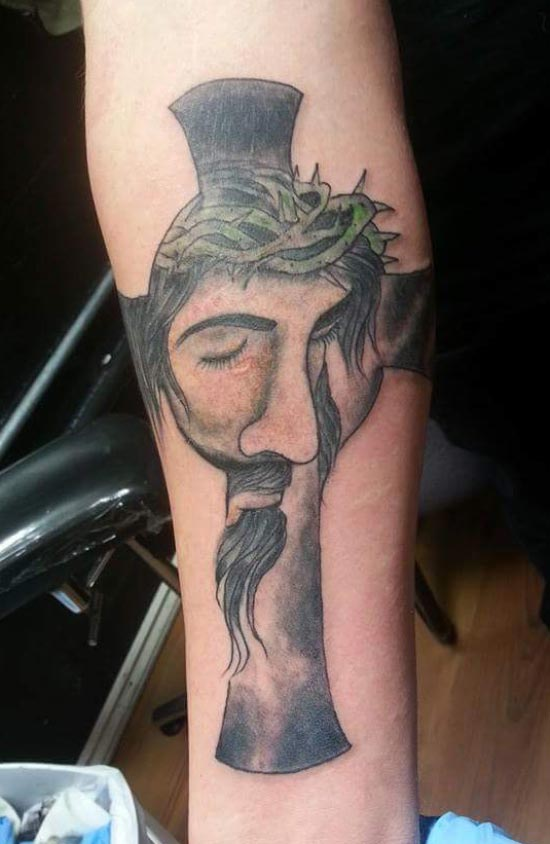 Worst Bad Tattoos: horrible Jesus face on cross, warped