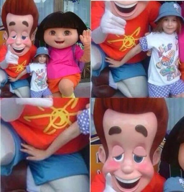 Funny Pictures: girl posing with characters at amusement park, Dora the Explorer, her hand in is Jimmy Neutron's crotch