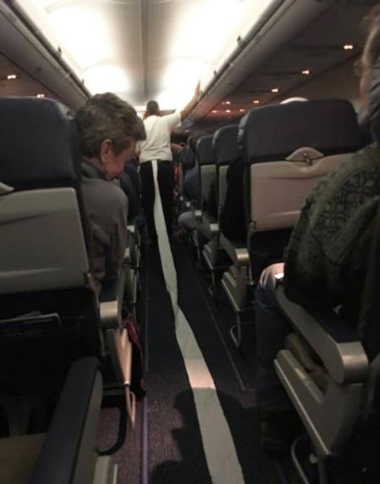 Funny Pictures: man walking down airplane aisle pulling toilet stuck to his shoe