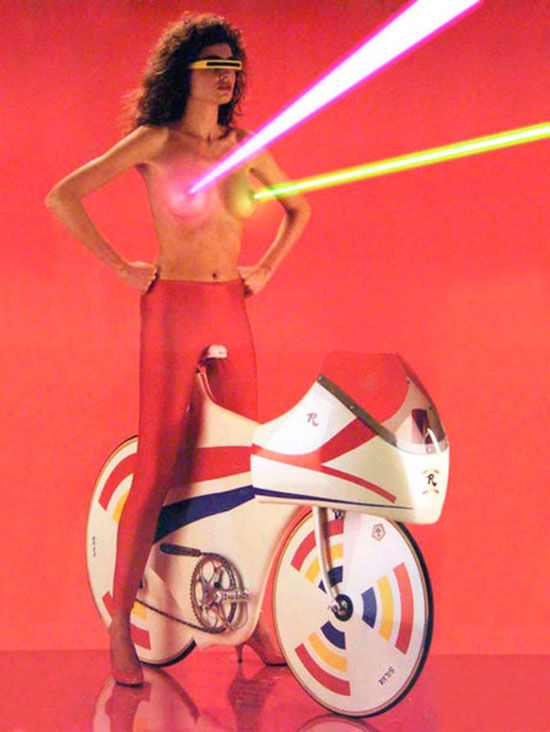 retro 1980s workout poster, woman with laser boobs on futuristic bike