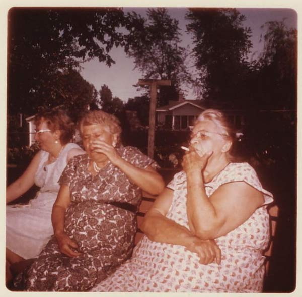 funny awkward family photos: old woman drinking and smoking in backyard